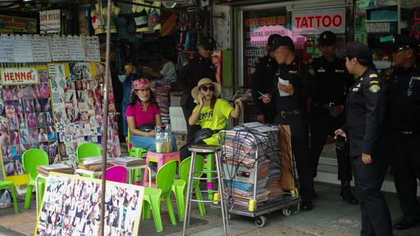 Thai vendors ignore ban on road stalls in Bangkok backpacker street