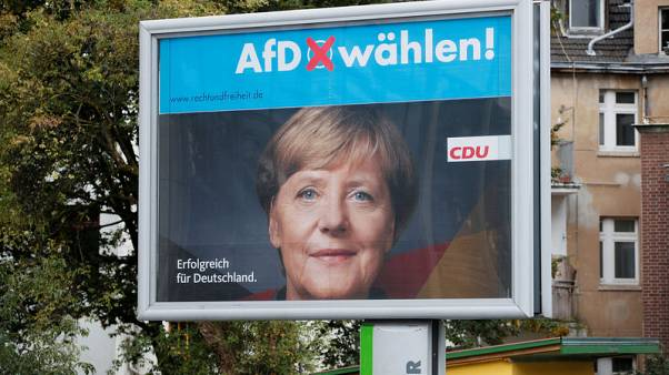 Support for Merkel's bloc hits record low, AfD at new high - poll