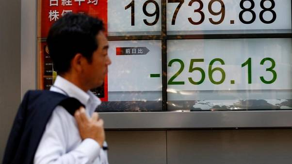 Asia stocks restrained, dollar at two-week high as trade war saps confidence