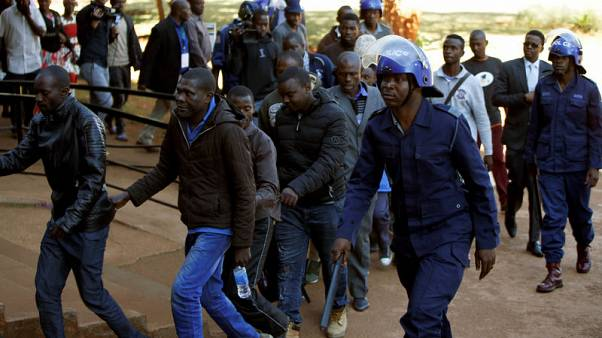 Zimbabwe opposition members in court over post-election violence, victims buried