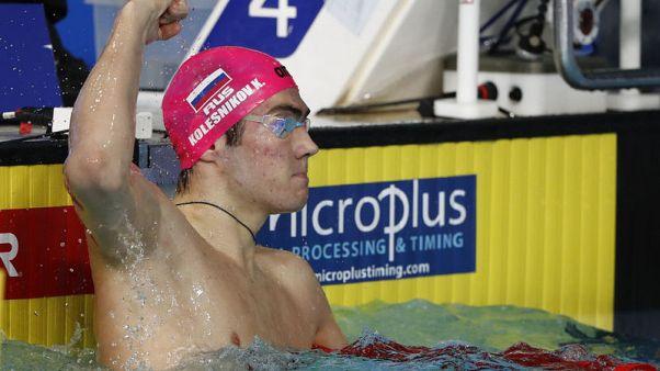 Kolesnikov sets 50m backstroke world record to win European title