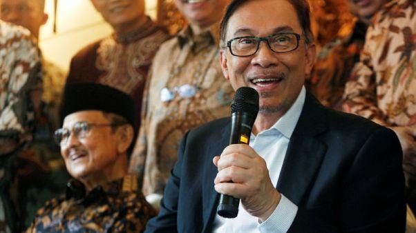 Malaysia's Anwar Ibrahim wins party presidency