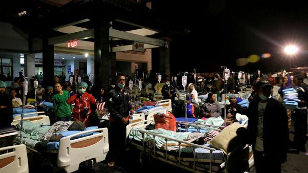 Tourists flee Indonesia's Lombok island after earthquake kills 98