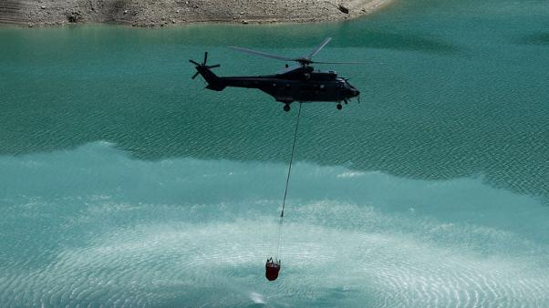 Swiss army airlifts water to thirsty cows in drought-hit pastures