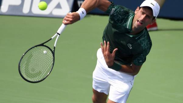 Djokovic ends lucky loser Basic's unexpected Toronto start