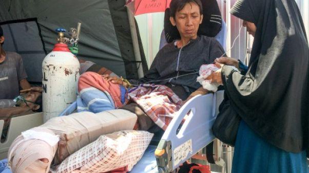 """""""Pourquoi vous m'abandonnez?"""": un blessé du séisme en Indonésie raconte le chaos"""