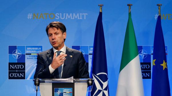 Italy to defend its interests on budget but not make 'foolish' demands - PM says