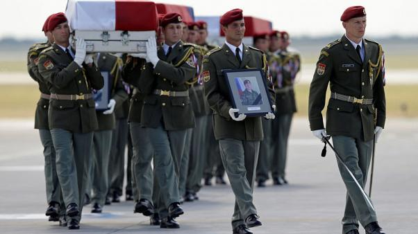 Czech plane returns bodies of soldiers killed in Afghanistan to Prague