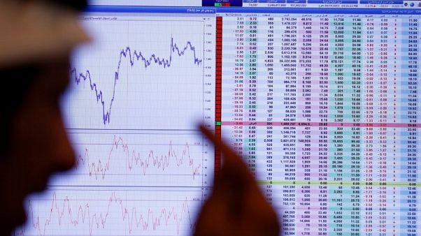 بورصة أبوظبي تسجل أعلى مستوى في 4 سنوات والسوق السعودية تتراجع وسط نزاع مع كندا