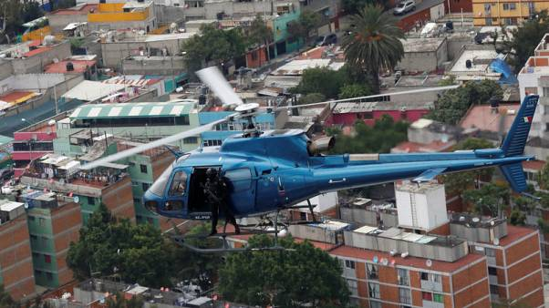 Police choppers thump over Mexico City as drug crime rises