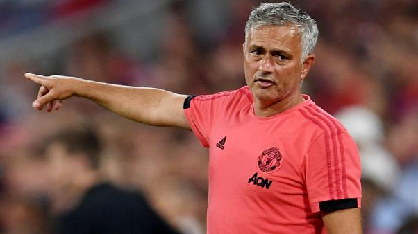 Soccer - Mourinho takes swipe at United's detractors