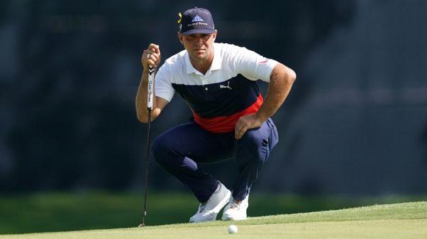 Golf - Woodland chops away to take lead at PGA Championship