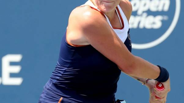 Tennis - Halep outlasts Pavlyuchenkova to reach third round in Montreal