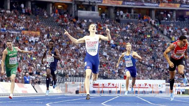 Athletics - Warholm wins first leg of audacious one-lap double