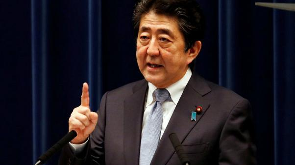 Japan PM Abe on track for extended term despite rival's bid