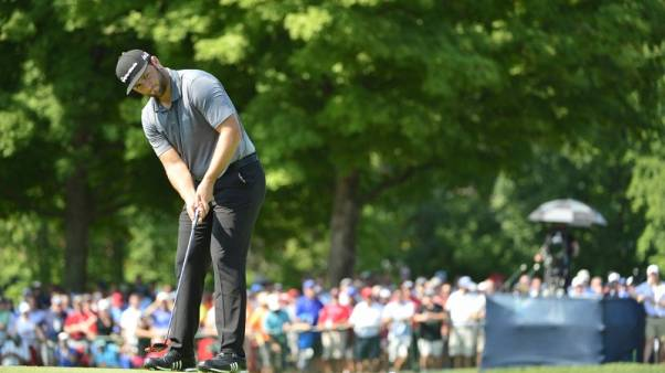 Golf - Rahm incurs penalty stroke for stepping on ball
