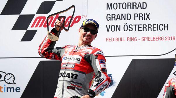 Lorenzo staves off Marquez challenge to win Austrian GP