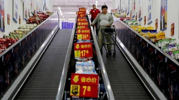 China's economy cools further, investment growth at record low