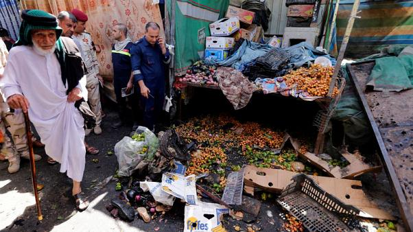 Bomb kills two in crowded Baghdad market - police