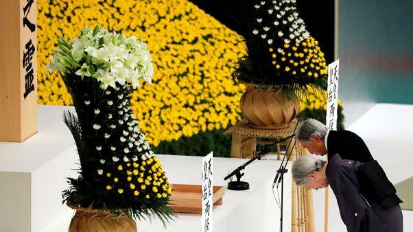 Japan emperor expresses 'deep remorse' over war; PM sends offering to shrine