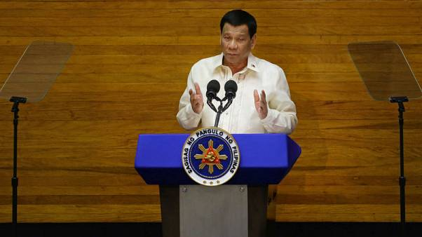 Philippine leader says China wrong to police airspace over disputed sea