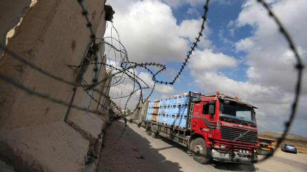 Israel lets food, goods back into Gaza as Egypt pushes truce