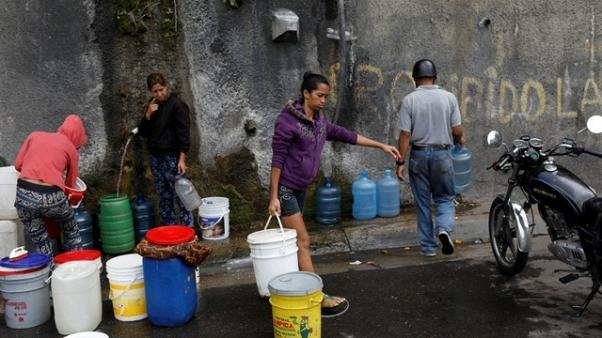 Hospitals scrap surgeries, Venezuelans forgo showers as taps run dry