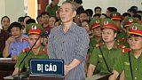 Le Dinh Luong devant le tribunal de Nghe An au Vietnam, le 16 août 2018