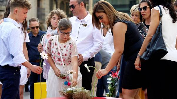 Barcelona remembers Islamist attacks as political tensions remain