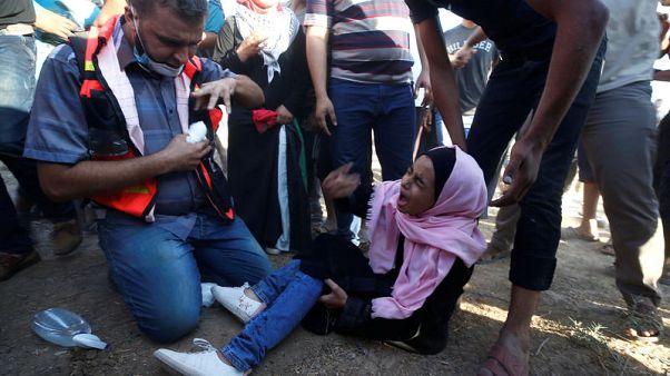 Israeli troops kill two Palestinians in Gaza border protests - medics