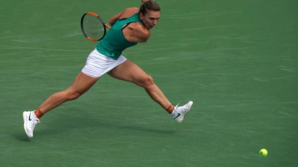 Halep downs Barty to move into quarter-finals