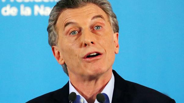 Argentina president says poverty to rise as economy slumps