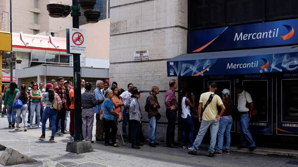 Venezuelans rush to shops before monetary overhaul