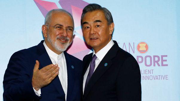 أكبر دبلوماسي بالصين يقول إن التعاون مع إيران سيستمر