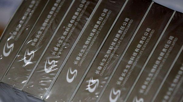 China sacks six senior officials at food and drug regulator over vaccine scandal