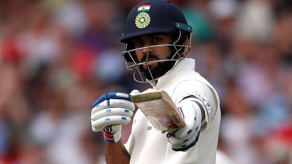 Kohli to India's rescue again after Woakes treble