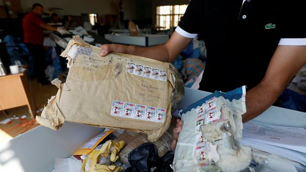 Eight years late, Palestinian mail arrives in West Bank