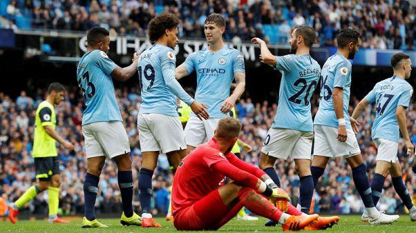 Aguero hat-trick as free-scoring City rout Huddersfield