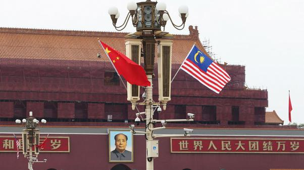 China, Malaysia sign MOU on bilateral currency swap agreement - Reuters witness