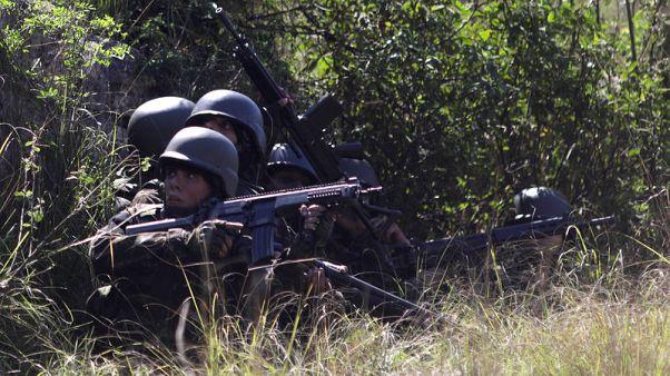 Twelve dead as Brazilian soldiers, police swarm Rio slums in anti-drug assaults