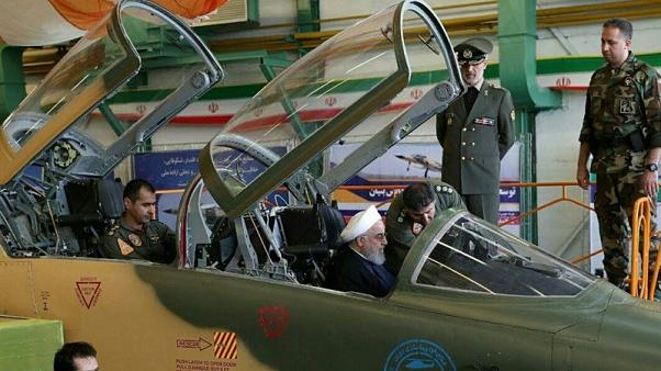 Eying U.S., Iran says to boost military might, showcases new fighter jet