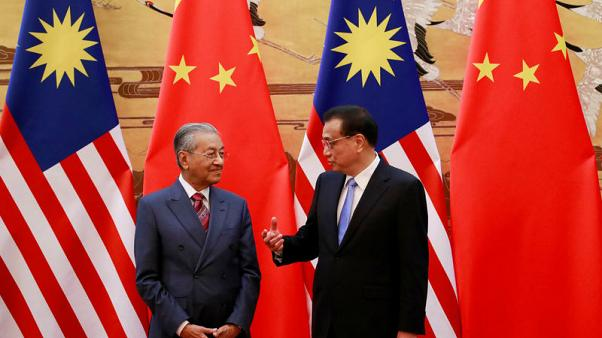 Malaysian PM Mahathir says China-backed rail, pipeline projects cancelled for now - reports