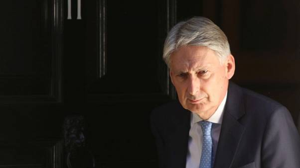 UK shows biggest July budget surplus since 2000, easing spending headache for Hammond