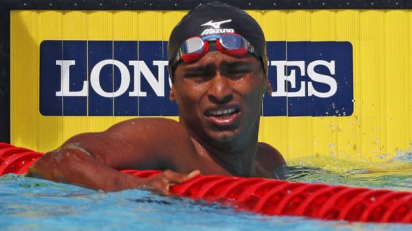 Asian Games - Family kept flood news away from swimmer to help him focus