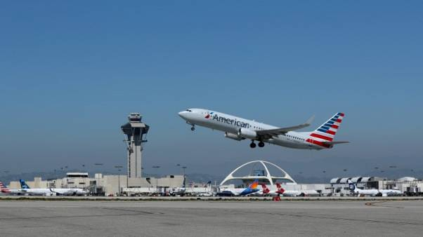 American Airlines cuts second U.S.-China flight; cites fuel, competition