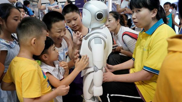 Trade tensions may power down China's robot industry