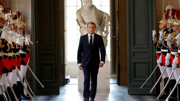 French business morale drops as 'Macron effect' eases