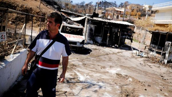 One month on, Greek wildfire victims face long road to normality