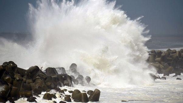 Typhoon Cimaron slices through western Japan, heads north