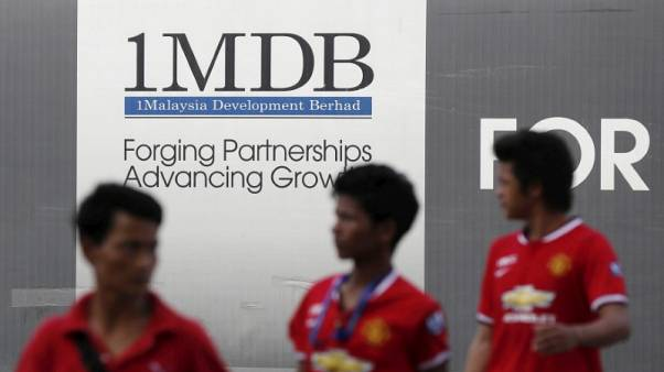 1MDB investigators file charges against wanted Malaysian Jho Low